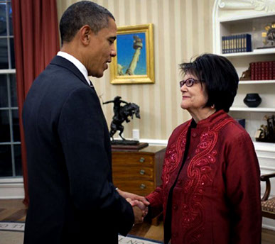 President Barack Obama and late American Indian Activist Elouise Cobell shaking hands in the White House.